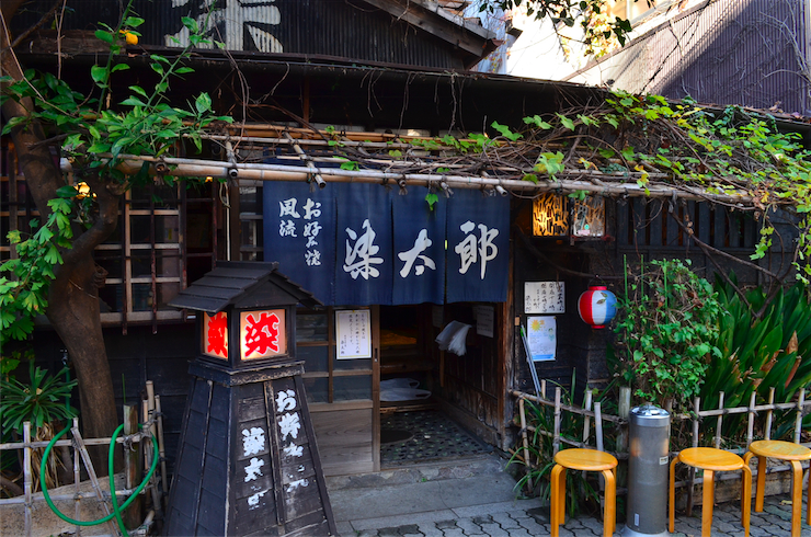The exterior of Sometaro gives some clue as to the legacy it holds; a rustic timber structure with a bamboo fence and a tall, leafy tree.