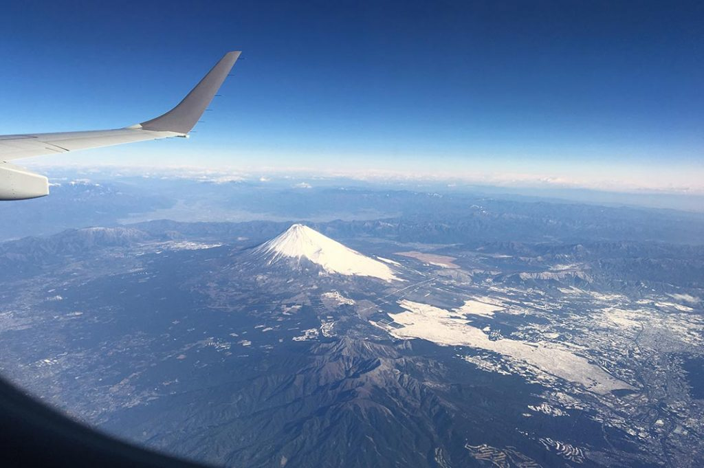 Mount Fuji is seen by the plane.