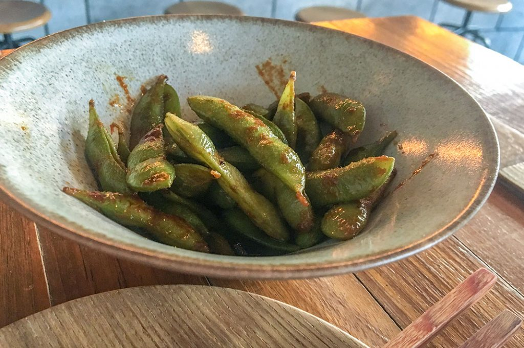 The garlic edamame are pan fried and have a deep, dark soy, garlic and chili flavour.