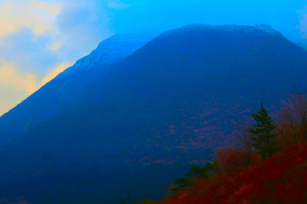 Round ashen mountains and volcanoes are characteristic of the southern Kagoshima landscape.