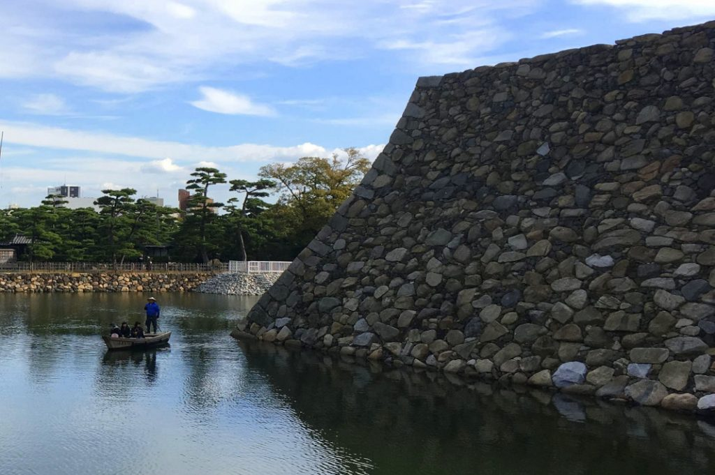 Visitors can boat through the moat of Takamatsu Castle