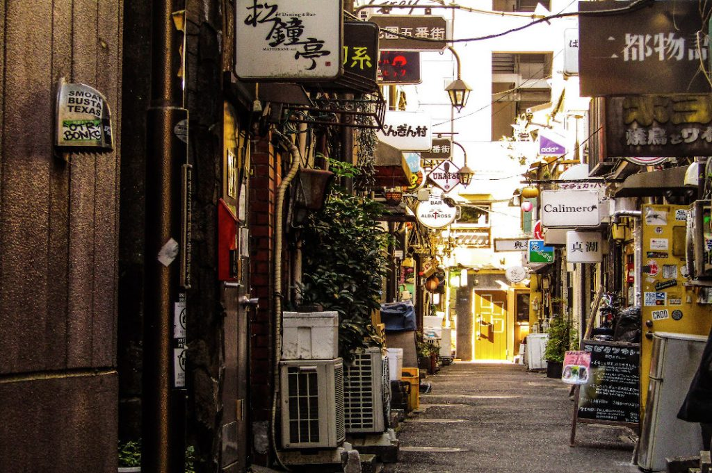 The collage-like storefronts of the Golden Gai are teeming with people on their own Shinjuku walks.