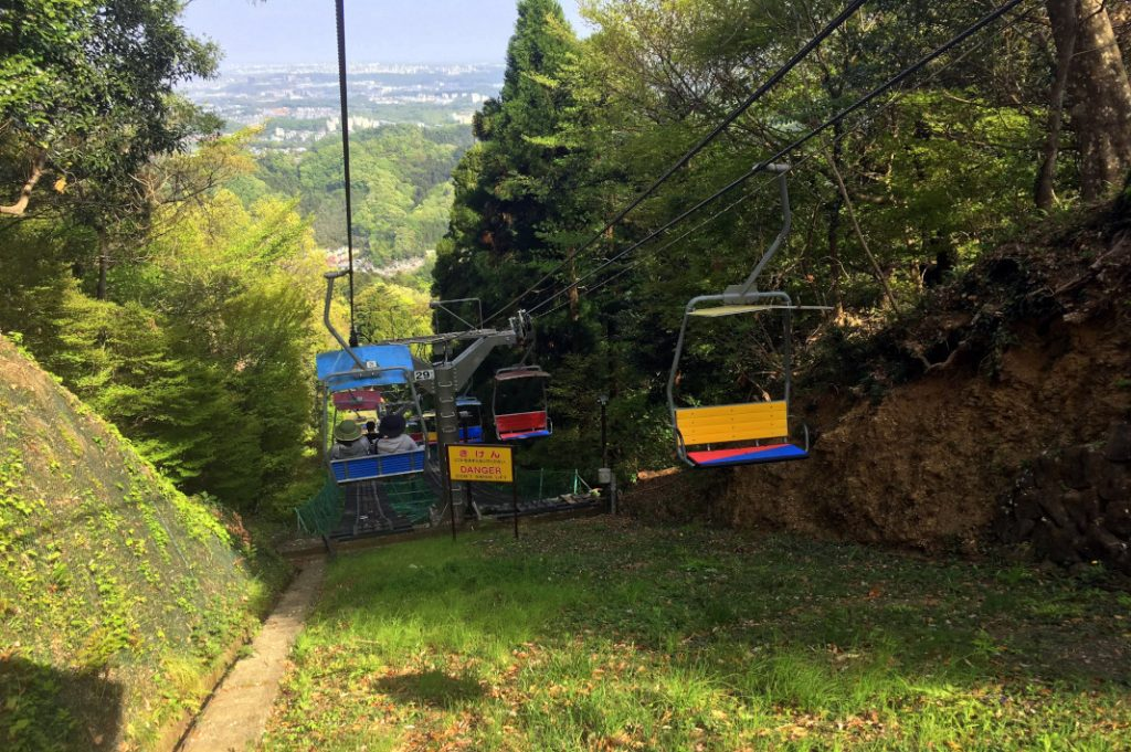 Chair lifts bring visitors halfway up Mount Takao, close to the monkey park