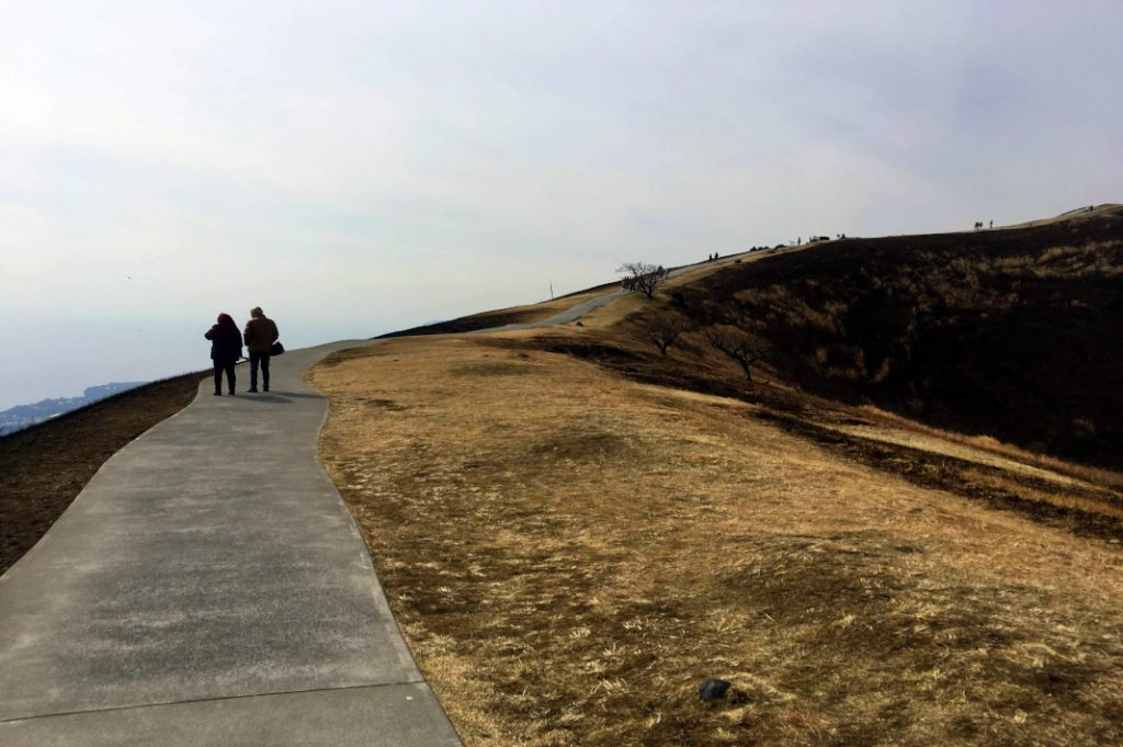 The walking trail winds around the Mount Omuro's rim.