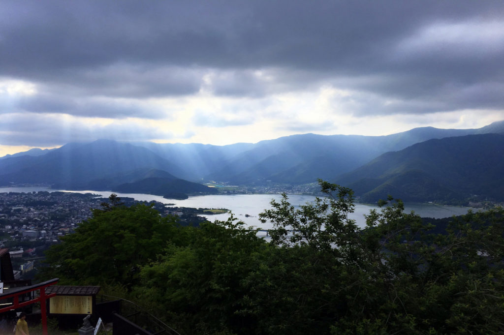 Sun breaks through the clouds over Lake Kawaguchiko—the perfect overnight trip from Tokyo