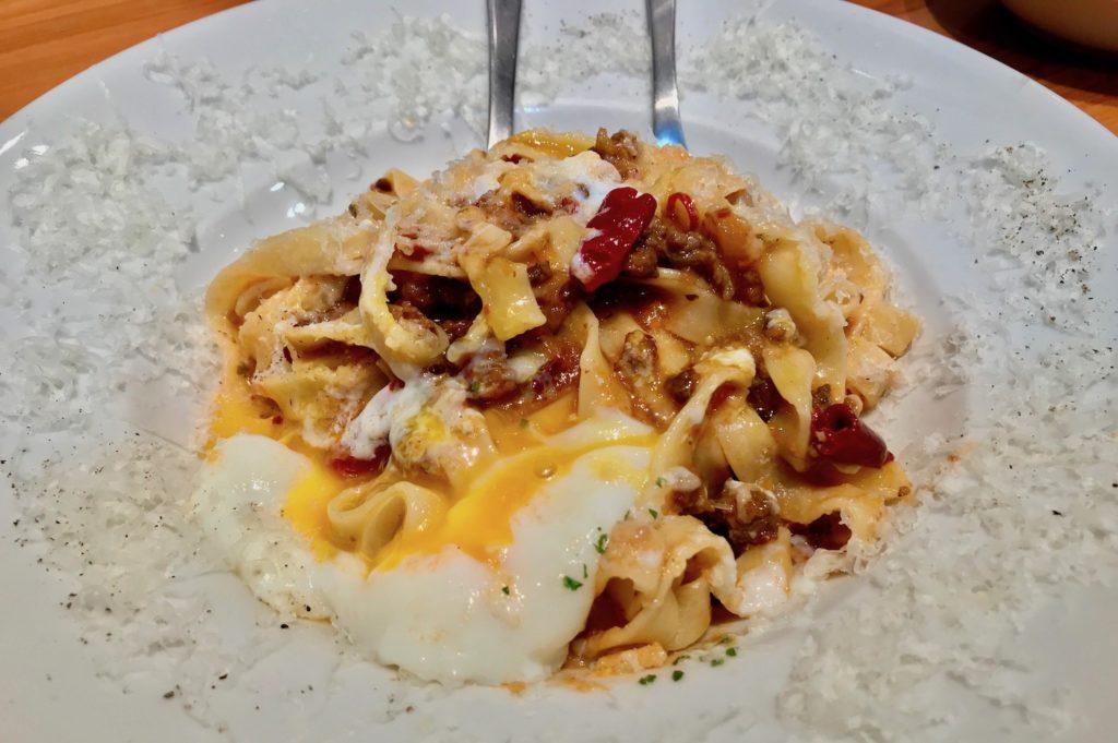 adding egg to the pasta at the yoyogi restaurant