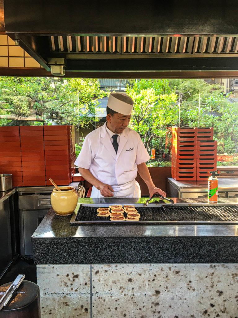Chef grilling tofu at Tofuya Ukai