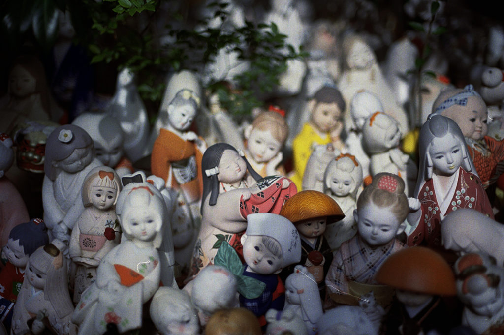 A large number of decorative dolls (these, depicting children) also 'live' in the grounds of the shrine.