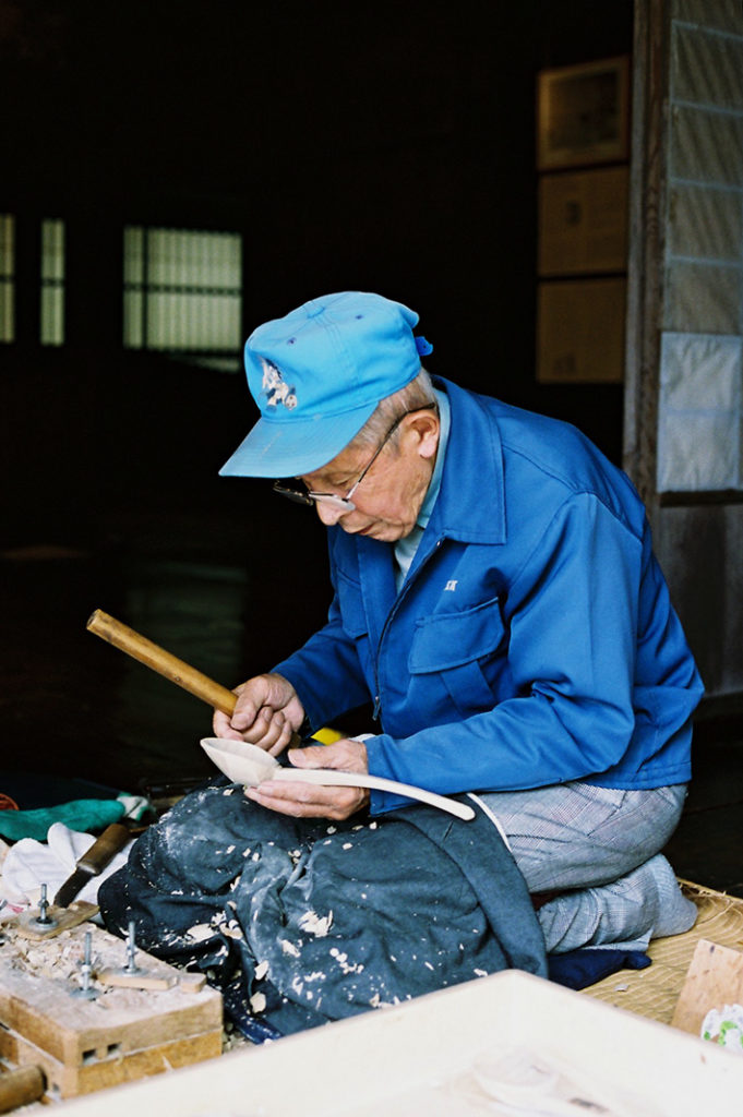 Master craftsmen are deeply absorbed in their traditional work.
