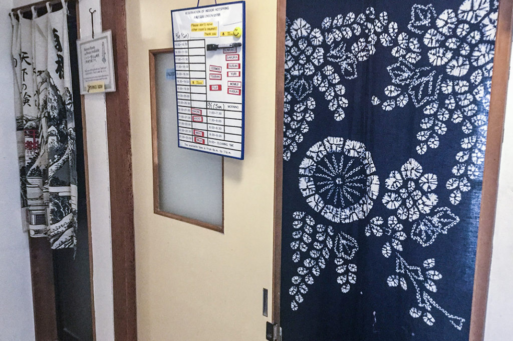 Onsen sign up board at Fuji Hakone Guest House