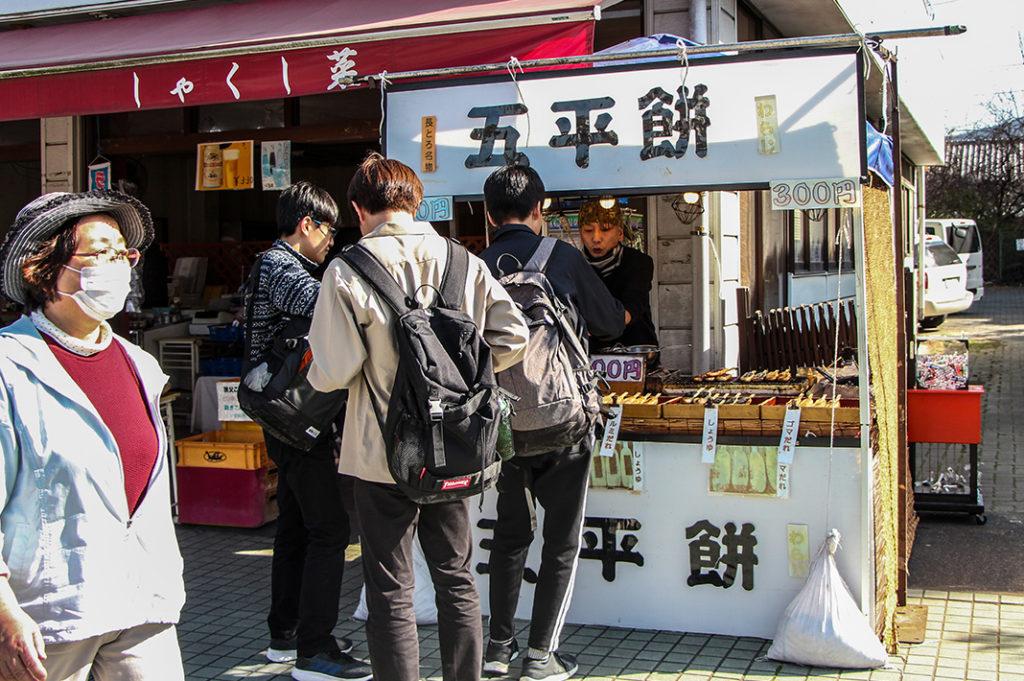 Enjoying tabe-aruki street food during your day trip to Nagatoro