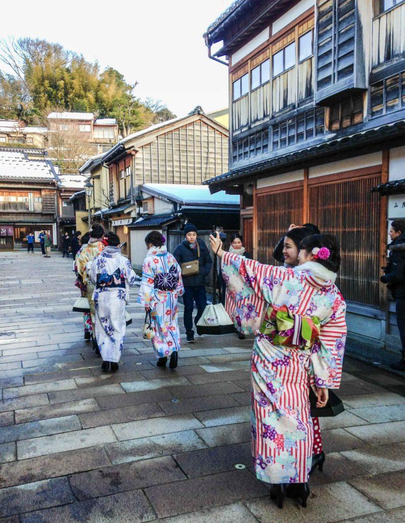 Not geishas, just friends posing for photos wearing kimono in Higashi Chaya