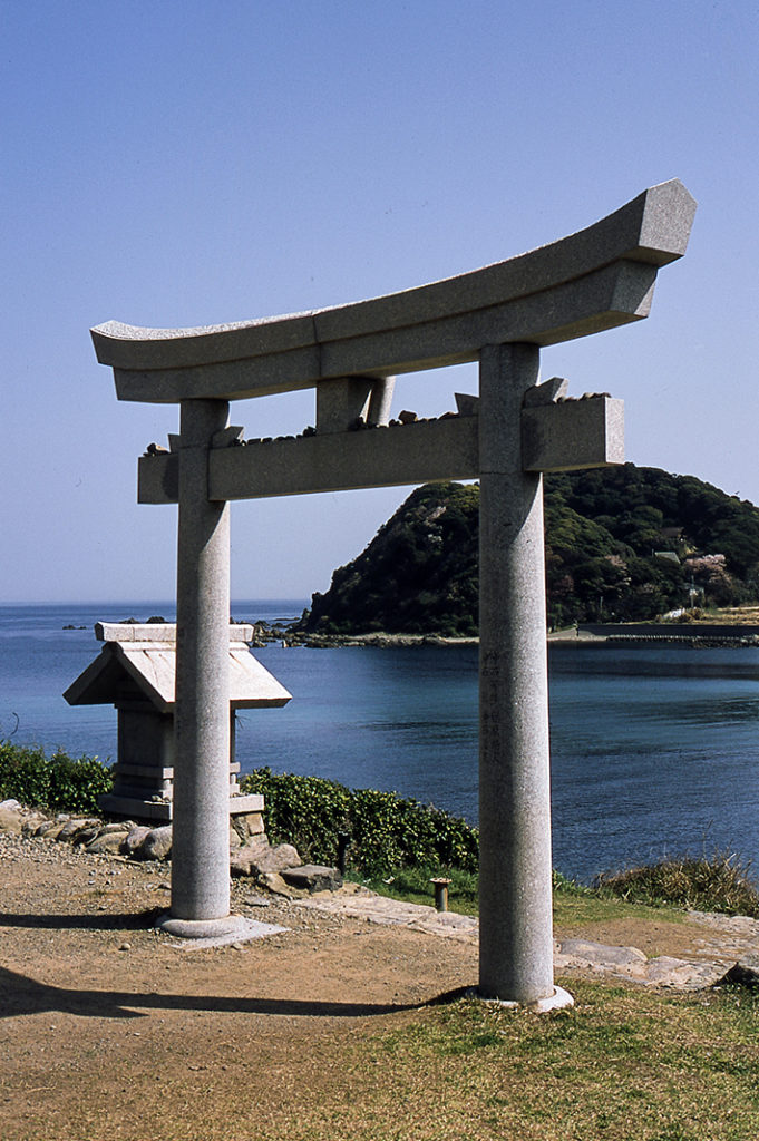 Oshima's coast is a mix of rocky cliffs and safe bays, dotted with small shrines and rickety houses. Munakata Taisha sits behind this torii gate.