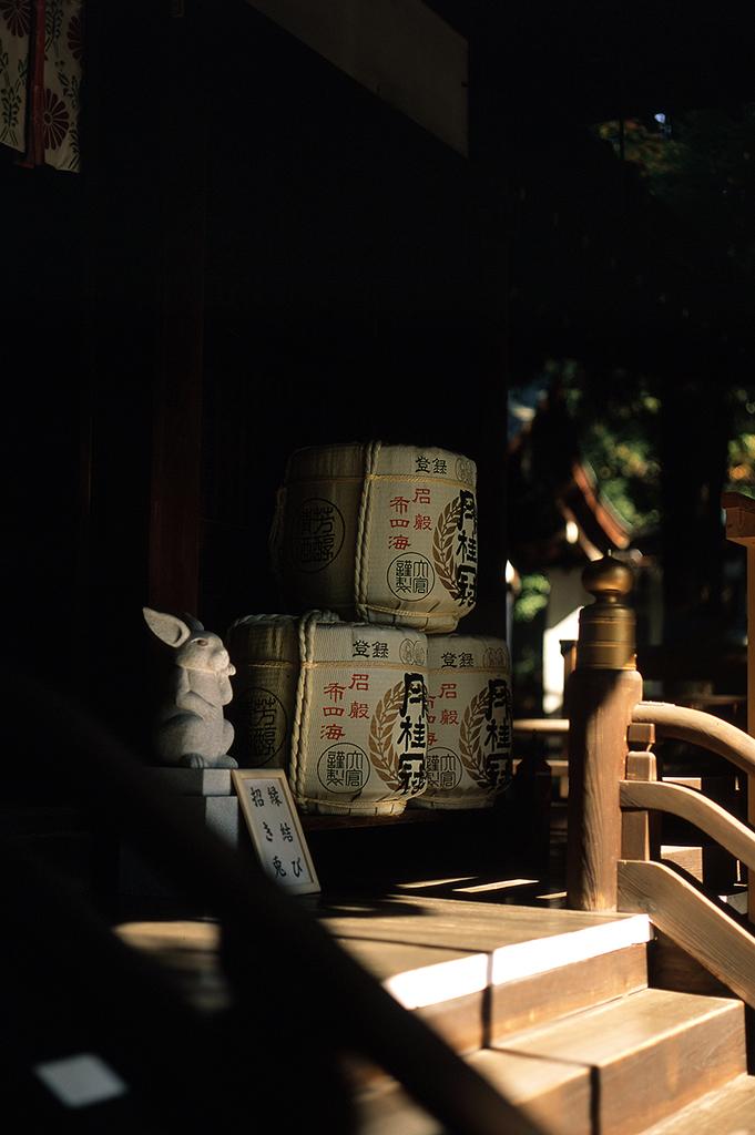 A common sight at Shinto shrines: stacks of 'Gekkeikan' sake barrels, made locally at a famous Fushimi-based brewery.