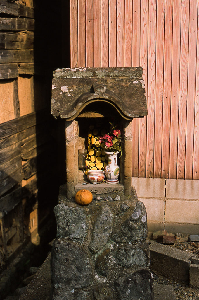 Spot the touch of Yayoi Kasuma at a roadside alter on Oshima island!
