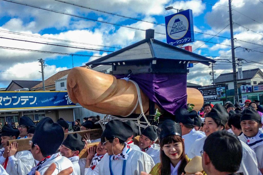The big phallus at the Komaki Penis Festival. The crowd follows the parade back to the shrine at Honen Matsuri in Komaki