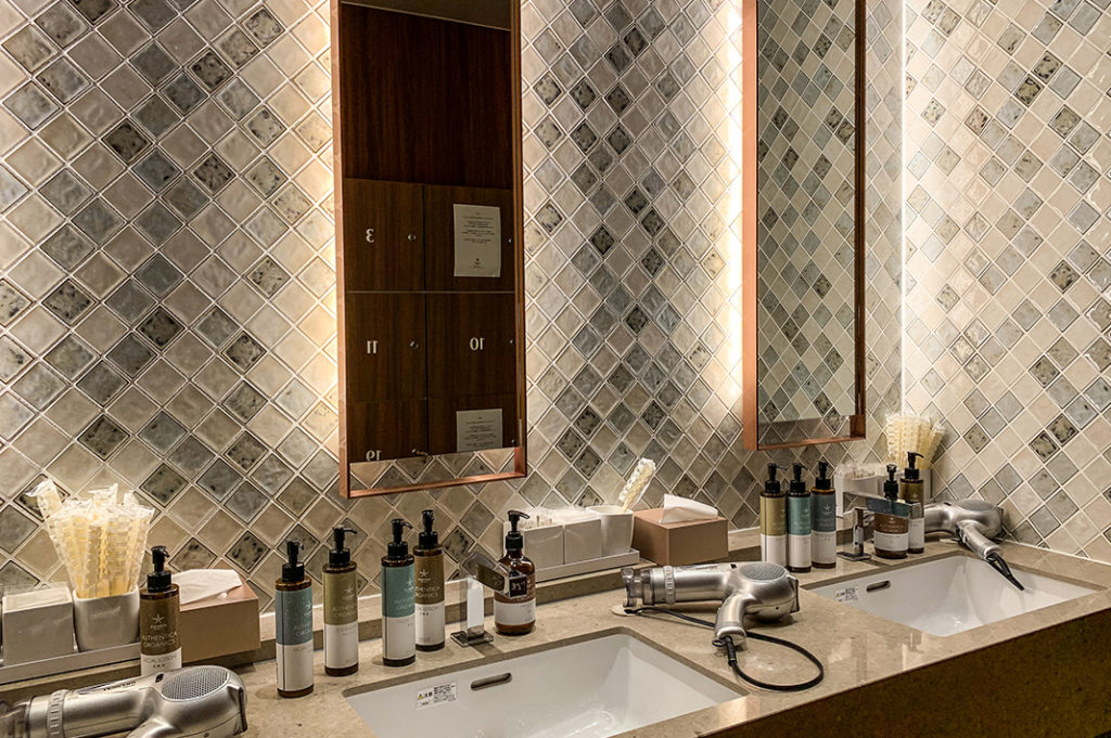Hairdryers and complimentary products in the women's bathroom.