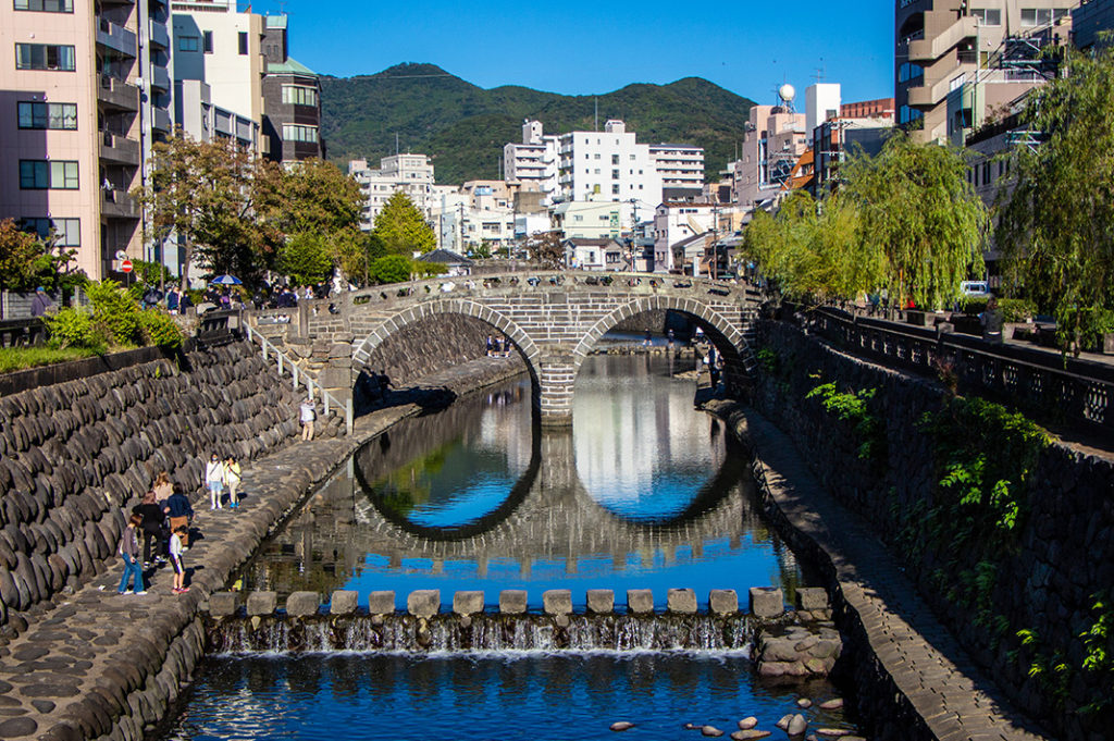 Meganebashi stone bridge is said to be one of the oldest in Japan. Its double arch design led to the nickname 'Spectacles Bridge'.
